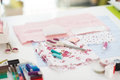 Closeup on table of seamstress with scissors threads and fabric Royalty Free Stock Photos