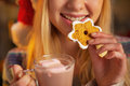 Closeup on teenager girl drinking cup of chocolate hot with marshmallow and christmas cookie Royalty Free Stock Photos