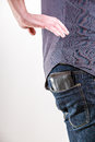 Closeup. Thief stealing wallet from back pocket of man. Theft. Royalty Free Stock Photo
