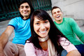 Closeup of three friends sitting together on steps Royalty Free Stock Photo