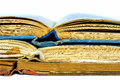 Closeup of three old books opened spine Royalty Free Stock Photo