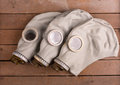 Closeup of three old gas masks on wooden box Royalty Free Stock Photo