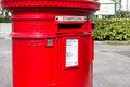 Closeup to a bright red post box london uk th march during the day Stock Photo