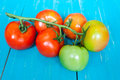 Closeup of tomatoes on the vine on wood Stock Image