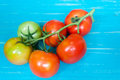 Closeup of tomatoes on the vine on wood Stock Photography