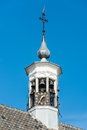 Closeup of a tower with carillon and clock Royalty Free Stock Images