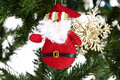 Closeup of toy in christmas tree decorations Royalty Free Stock Images