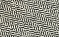 Closeup of tweed fabric black and white herringbone Stock Photos