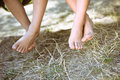 Closeup of two children legs barefoot on sunny Royalty Free Stock Photo