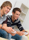 Closeup of two friends playing video game Stock Photography