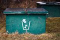 Closeup of two garbage bins in a campground