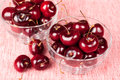 Closeup of two glass bowl full of cherries on the table Royalty Free Stock Image