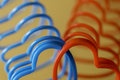 Closeup of two heart-shaped slinky toys intertwined, love concep Royalty Free Stock Photo