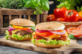 Closeup two homemade burgers made ​​from fresh vegetables old wooden table Royalty Free Stock Photography