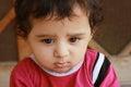 Closeup-up portrait headshot of a adorable sad boy thinking Royalty Free Stock Photo