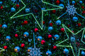 Closeup view of an artificial christmas tree decorated with balls electrical stars and snowflakes Stock Image