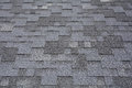 Closeup view on Asphalt Roofing Shingles Background. Roof Shingles - Roofing. Royalty Free Stock Photo