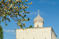Closeup view of assumption church at the yaroslav s courtyard in veliky novgorod russia domes lit by sunset light Royalty Free Stock Images