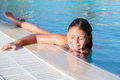 Closeup view of beautiful gorgeous pretty little girl relaxing and swimming in pool with natural ocean water Royalty Free Stock Photo