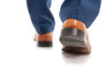 Closeup view of businessman shoes from behind Royalty Free Stock Photo