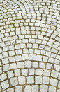 Closeup view on a cobblestone road pattern background Royalty Free Stock Photos