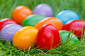 Closeup view of colorful easter eggs on the green grass Royalty Free Stock Photo