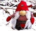 Closeup view cute elf in snow. Creative for colourful greeting card with copy space. Royalty Free Stock Photo