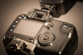Closeup view of digital camera grey background Royalty Free Stock Images