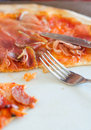 Closeup view of half pizza on a plate Stock Images