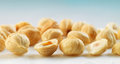 Closeup view of hazelnuts on blue background Royalty Free Stock Photo
