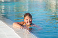 Closeup view of joyful happy little girl swimming in water pool