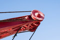 Closeup view of a railway crane boom or arm and ropes against th the background clear blue sky Stock Photography