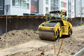Closeup View on the road roller working on the new road construction site Royalty Free Stock Photo