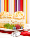 Closeup view of whipped cream cake garnished with berries Stock Photo