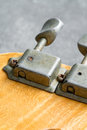 Closeup of vintage electric guitar tuners Royalty Free Stock Photo