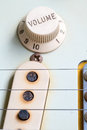 Closeup of vintage electric guitar volume knobs Royalty Free Stock Photo