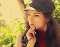 Closeup vintage portrait of thinking young woman in trendy hat Royalty Free Stock Photography