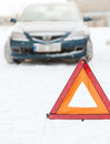 Closeup of warning triangle and car Stock Images