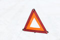 Closeup of warning triangle on snow Stock Photos
