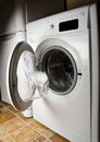 Closeup of washing machine door with empty drum Royalty Free Stock Photo