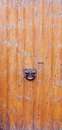 Closeup weathered wooden door rusty knocker Royalty Free Stock Photography