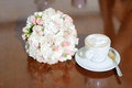 Closeup wedding bouquet cup coffee table Royalty Free Stock Photography