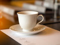 Closeup white cup of coffee break in the meeting room Royalty Free Stock Photo