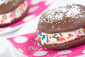 Closeup of whoopie pie chocolate cake dessert decorated with sprinkles and sugar shallow depth field Stock Photography