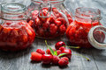 Closeup of wild starwberry compote on old table Stock Photography