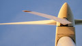 Closeup of a wind turbine from below with evening sunlight Stock Photos