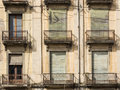 Closeup of windows of an old spanish house Royalty Free Stock Photo