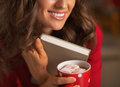 Closeup on woman with christmas cup of hot chocolate hugging book young marshmallow Royalty Free Stock Image