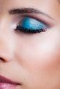 Closeup of woman closeed eye with blue eye shadow Royalty Free Stock Photo