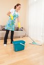 Closeup of woman doing housework and cleaning beautiful girl mopping floor in bedroom Stock Photo